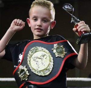 Oliver Clarke and a title belt